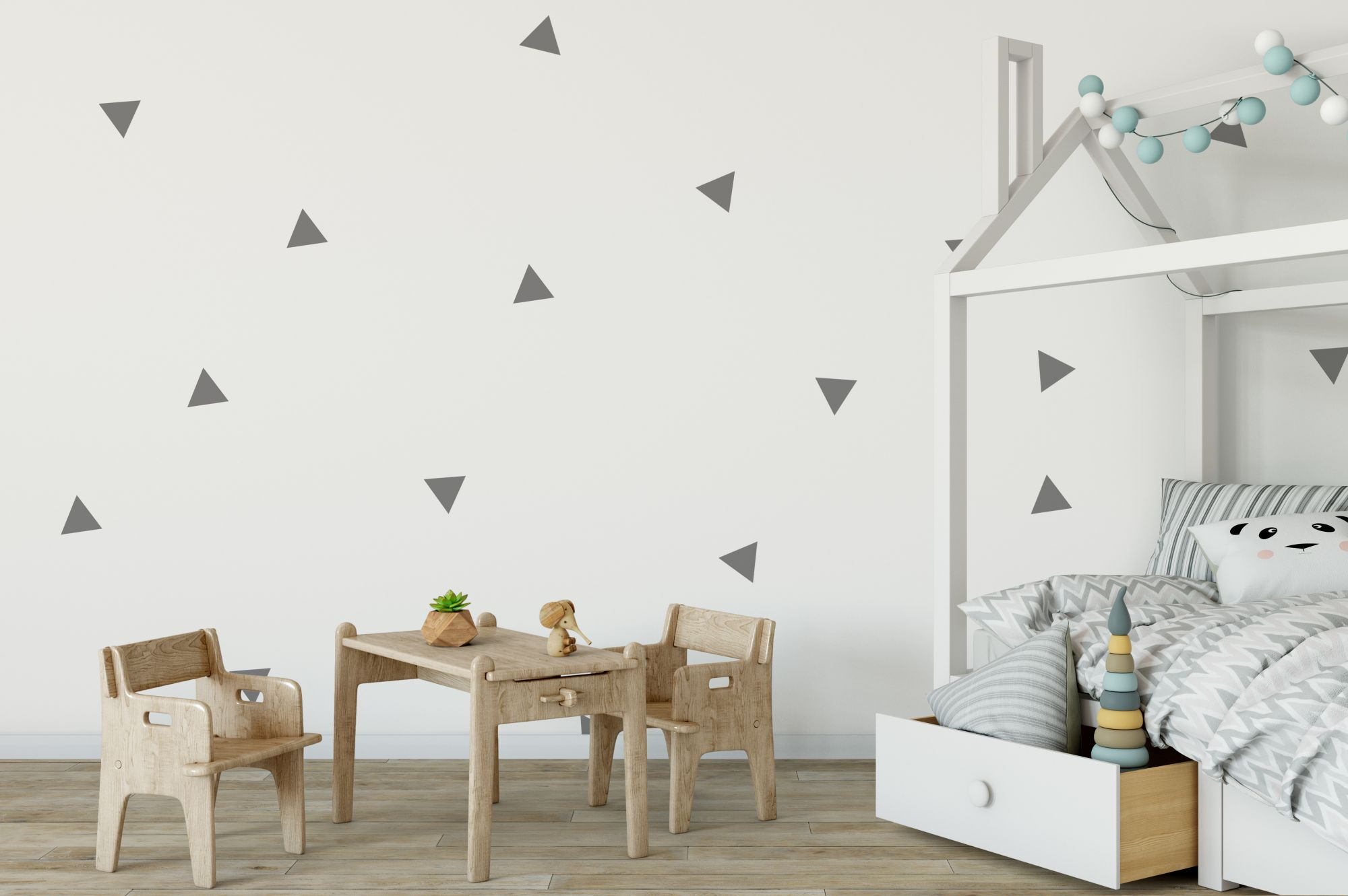 Pareti decorate con geometrie nella cameretta dei bambini
