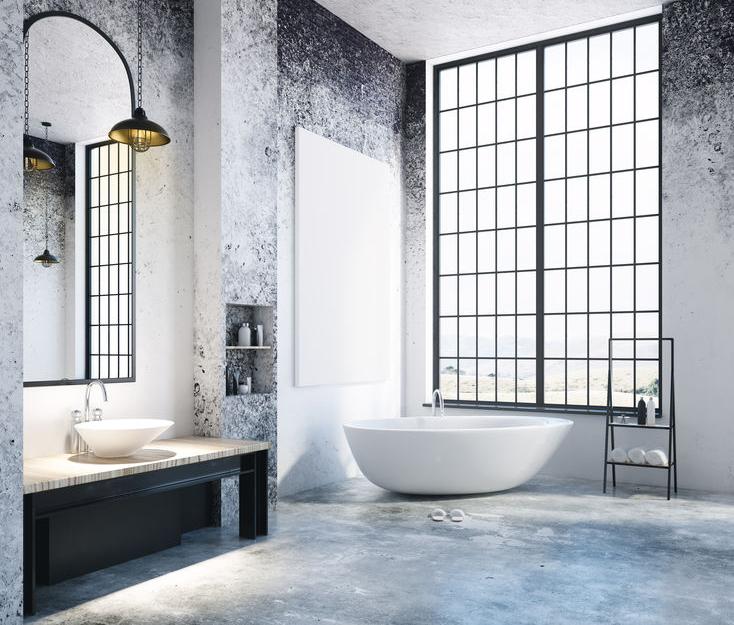Bagno con pavimento in cemento