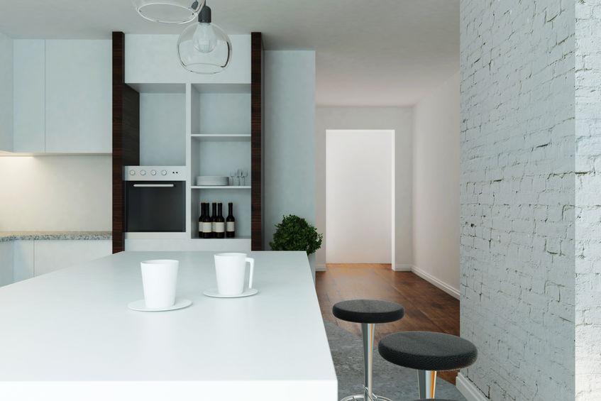 Cucina industrial chic con dettagli in mattoni bianchi