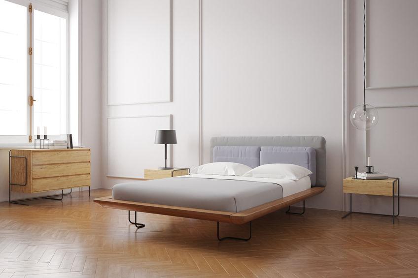 Zona notte: struttura mista in legno e ferro per il letto
