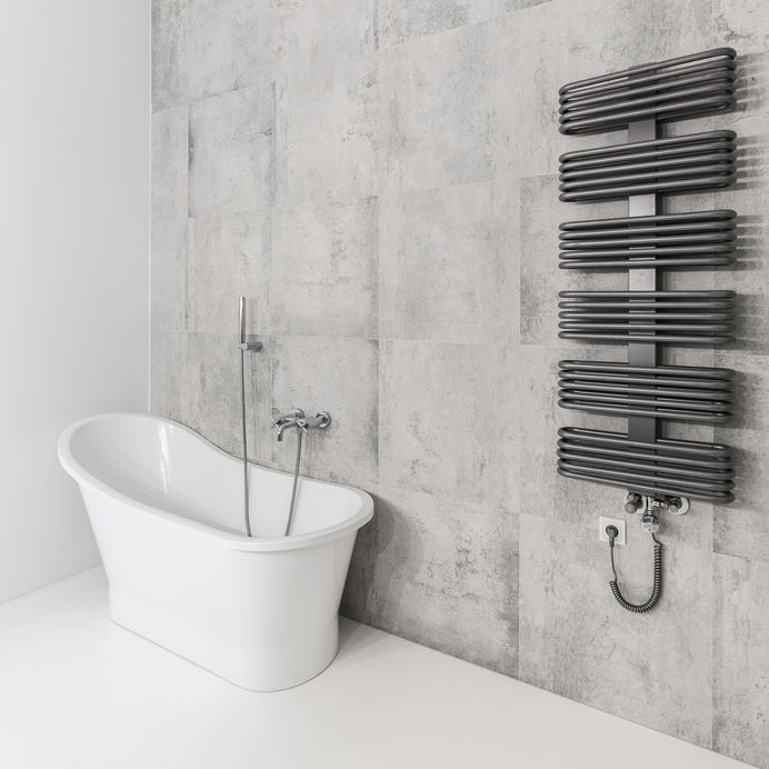 Termoarredo in bagno elettrico: curvilineo e contemporaneo