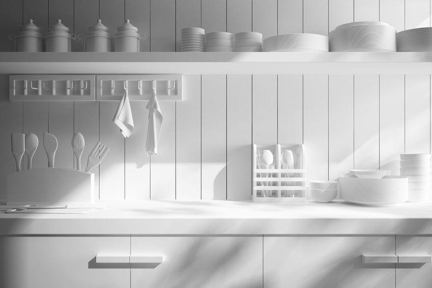 Paraschizzi in cucina in legno bianco