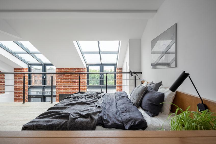 Loft in stile industriale: camera da letto